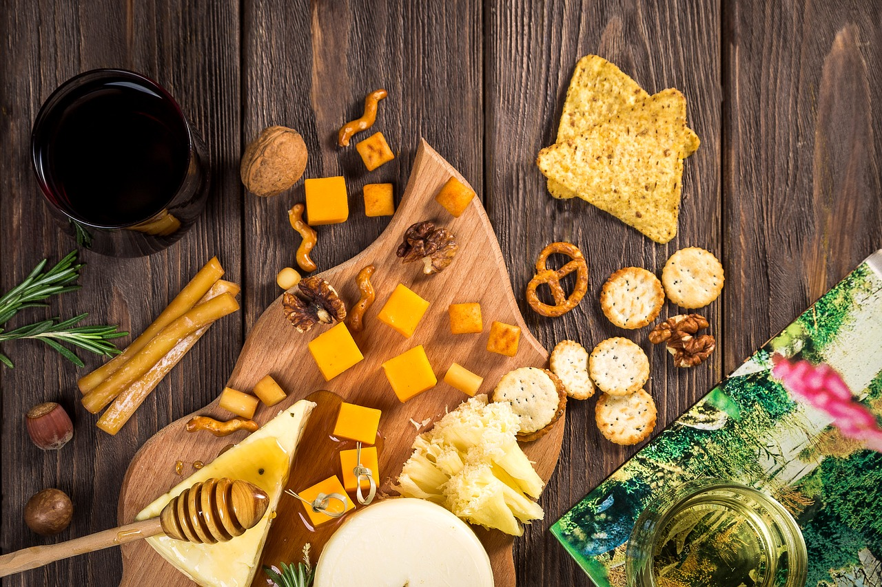 wine and cheese with nuts, pretzels and honey